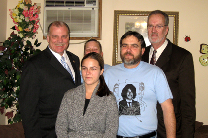 "Acting Governor Steve Sweeney and Senator Jim Whelan, D-Atlantic, pose for a picture with the Branca family in their home after signing ""Ricci's Law"" which would require certain first, second and subsequent offenders under the State's driving while intoxicated laws to install an ignition interlock device.  The Legislation was named after Ricci Branca, a 17-year old Egg Harbor Township resident who was killed by a repeat drunk driver in 2006.  Pictured in ActGovSweeneyWhelanBrancas2.jpg, from left to right – Acting Governor Steve Sweeney; Sherri Branca (background); Adrienne Branca (foreground); Richard Branca, Sr.; Senator Jim Whelan."