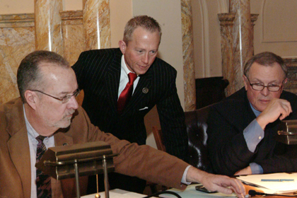 From left to right: Senators Jim Whelan, D-Atlantic, Jeff Van Drew, D-Cape May and Cumberland, and Raymond J. Lesniak, D-Union, confer about legislation prior to a vote.