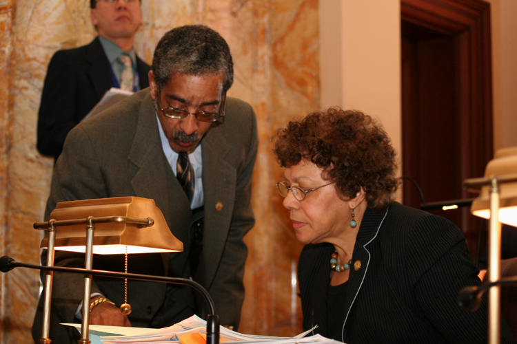 Senators Ronald L. Rice, D-Essex, and Shirley Turner, D-Mercer, speak on the Senate floor.